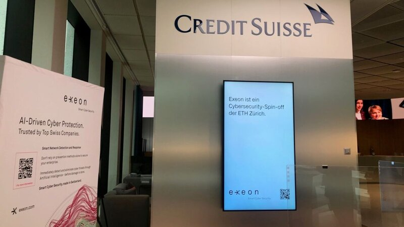 Screen at a Credit Suisse stand for a conference