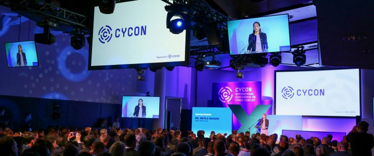 Woman presenting in front of an audience at Cycon 2019
